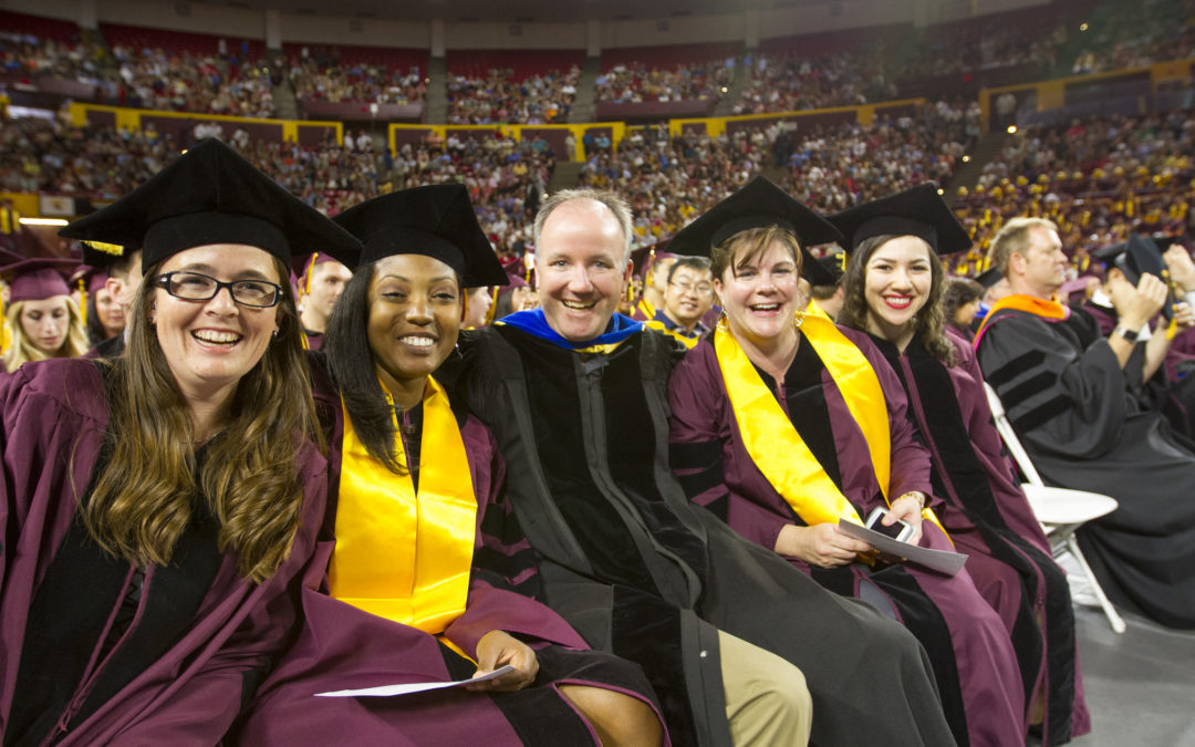Paul Westerhoff and four students pose together for a photo while participating in the convocation cermony